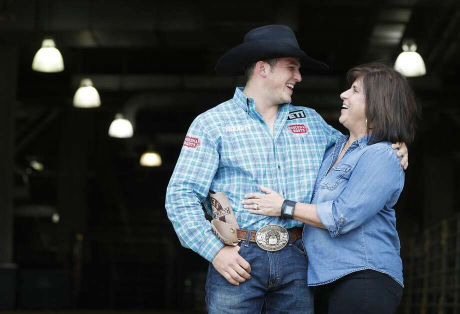 Richie Champion's mother, Lori Champion, loves the Houston Rodeo, because its means Richie will stay in their family home in The Woodlands for a few days. Photo: Karen Warren/Houston Chronicle