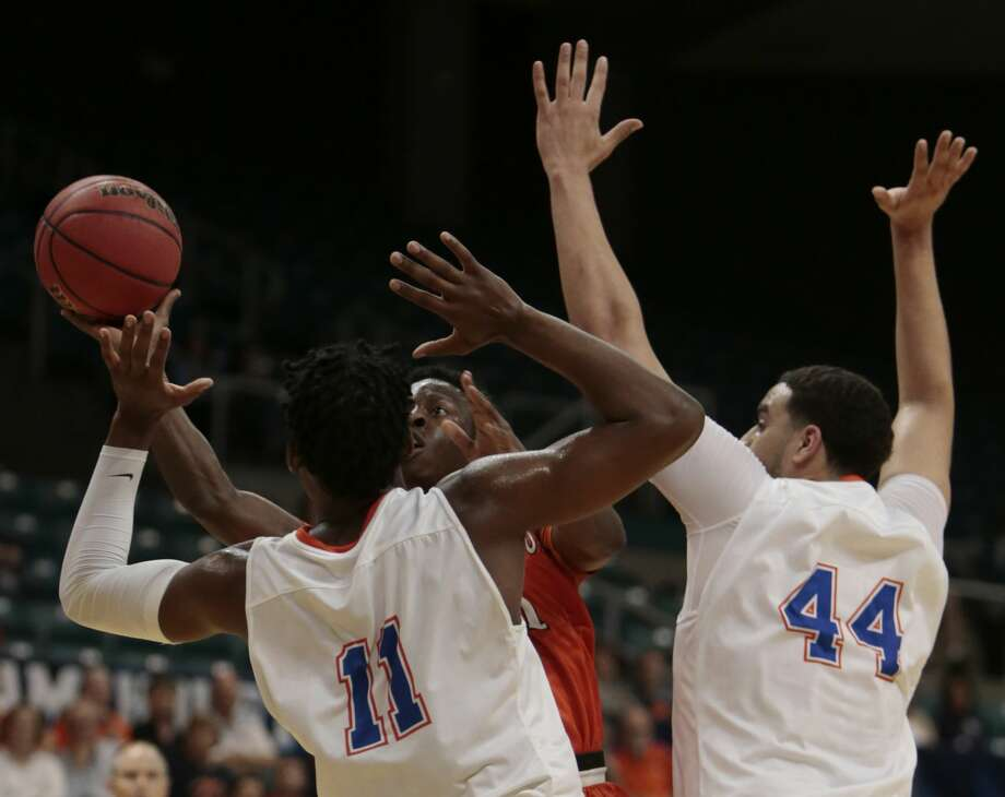 Sam Houston State guard John Dewey III drives to the basket between Houston Baptist guard Atif Russell (11) and center Josh Ibarra (44) during the first half of a Southland Conference Tournament quarterfinal basketball game at the Merrell Center on Thursday, March 9, 2017, in Katy. ( Brett Coomer / Houston Chronicle ) Photo: Brett Coomer/Houston Chronicle