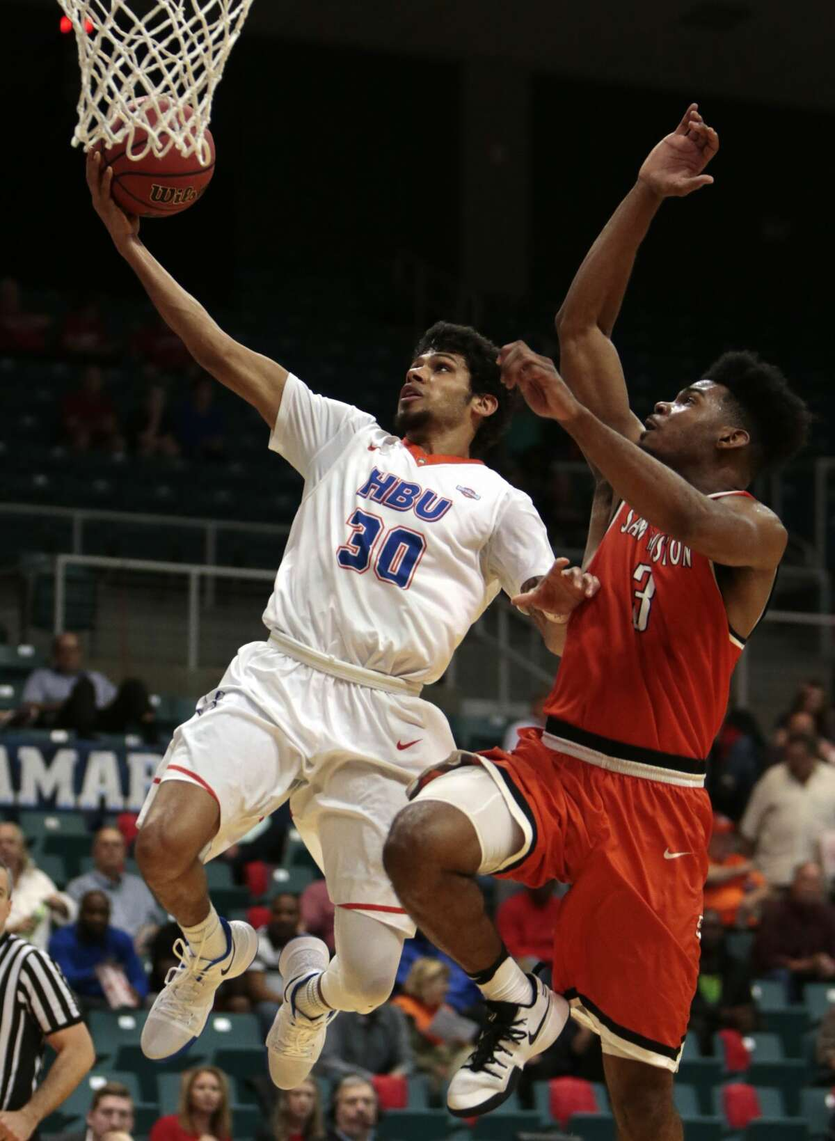 Houston Baptist guard Braxton Bonds (30) drives to the basket past Sam Houston State guard Dakarai Henderson (3) during the second half of a Southland Conference Tournament quarterfinal basketball game at the Merrell Center on Thursday, March 9, 2017, in Katy. ( Brett Coomer / Houston Chronicle )