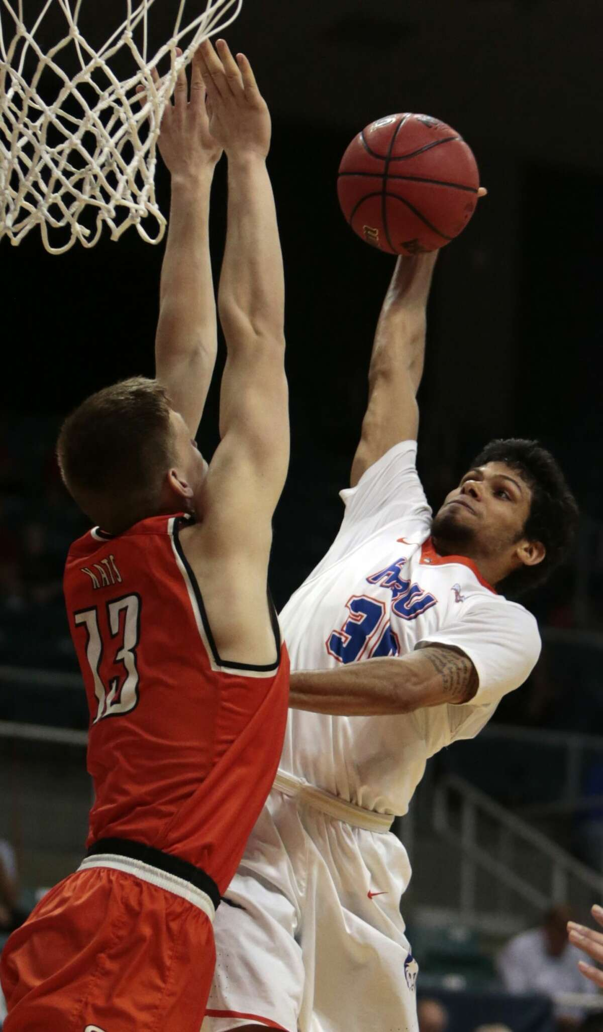 Houston Baptist guard Braxton Bonds (30) goes up for a shot against Sam Houston State forward Aurimas Majauskas (13) during the second half of a Southland Conference Tournament quarterfinal basketball game at the Merrell Center on Thursday, March 9, 2017, in Katy. ( Brett Coomer / Houston Chronicle )