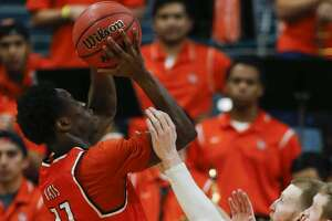 Sam Houston State guard John Dewey III (11) takes a shot against Houston Baptist during the second half of a Southland Conference Tournament quarterfinal basketball game at the Merrell Center on Thursday, March 9, 2017, in Katy. ( Brett Coomer / Houston Chronicle )