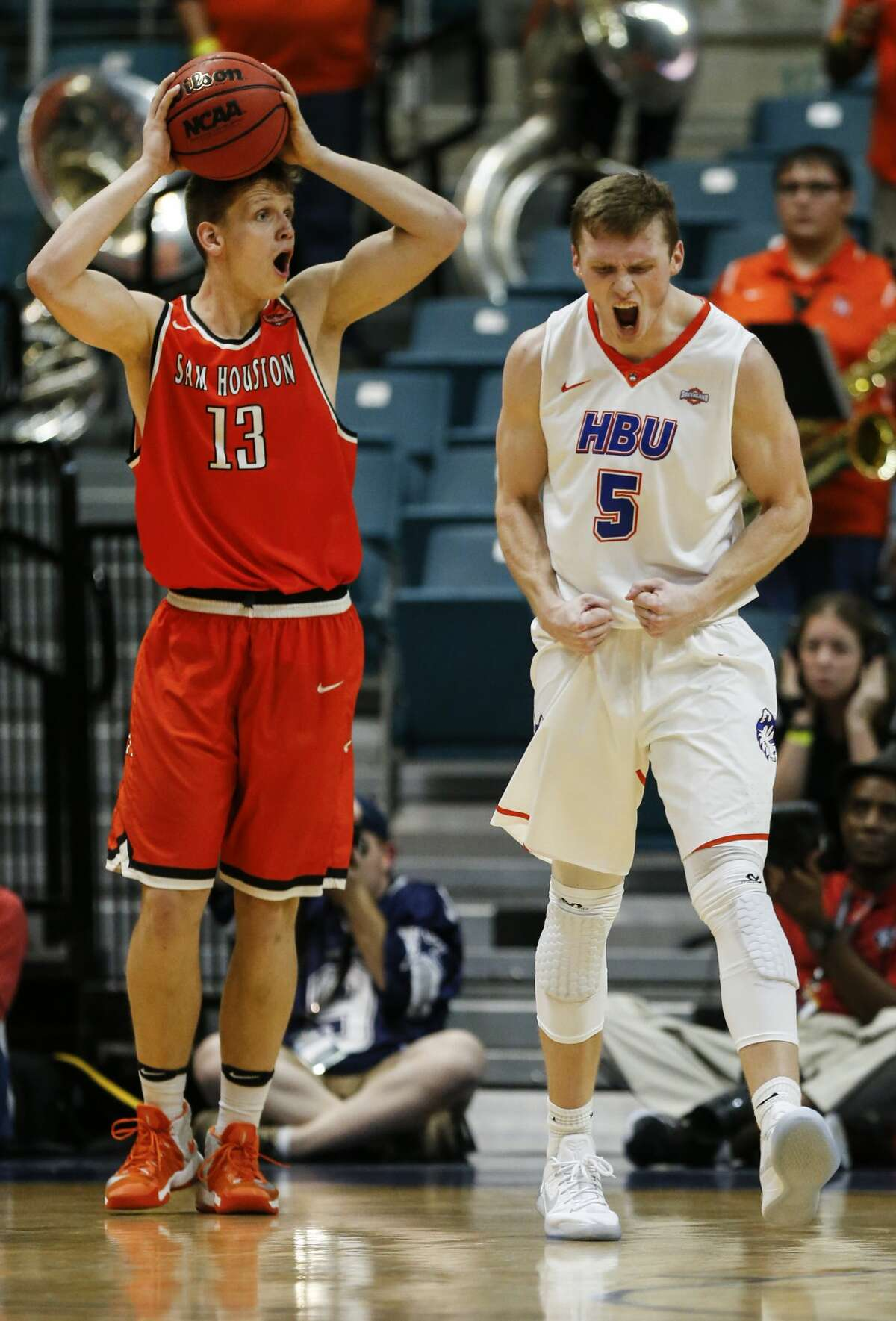 Sam Houston State forward Aurimas Majauskas (13) and Houston Baptist forward Colter Lasher (5) react to a foul called on Majauskas, forcing him to foul out, during the second half of a Southland Conference Tournament quarterfinal basketball game at the Merrell Center on Thursday, March 9, 2017, in Katy. ( Brett Coomer / Houston Chronicle )