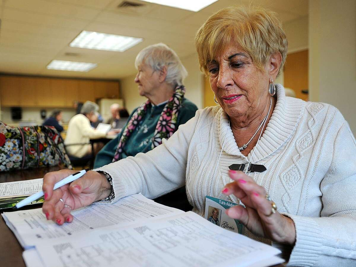 Volunteer Gloria Lanna, of Milford, reviews tax returns before filing at the AARP's Tax Aid Program at the Milford Senior Center in Milford, Conn. on Tuesday, March 7, 2017. Seniors and low income residents can have their taxes done for free on Tuesday and Thursday mornings from 9 am until noon. Lanna said that volunteers are able to complete about thirty returns per session at the Milford location.