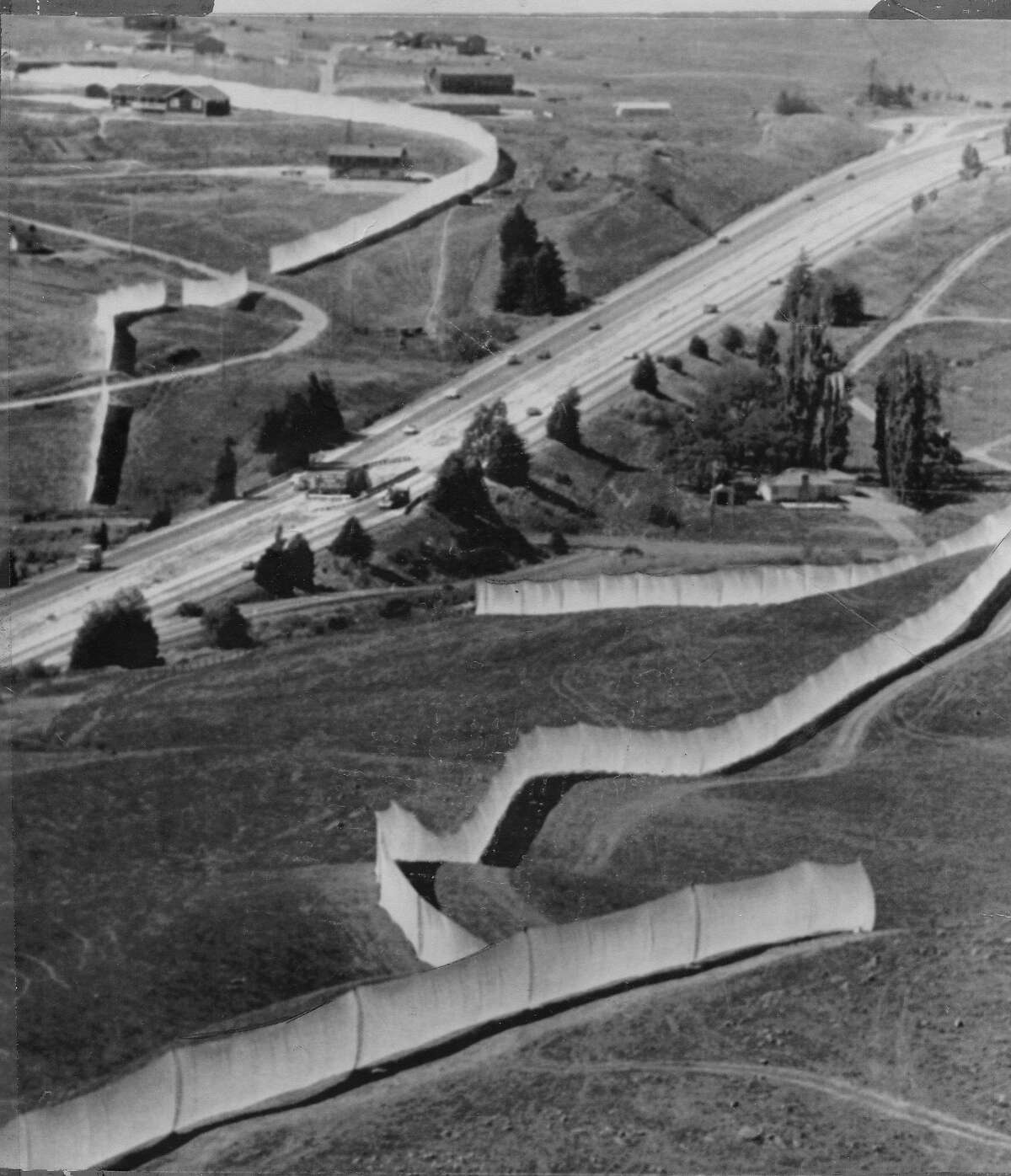New York artist Christo Javacheff pulls off his project after 42 months of meetings: a 24 mile long running fence. Seen here in Petaluma on both sides of Highway 101 September 9, 1976 Associated Press photo