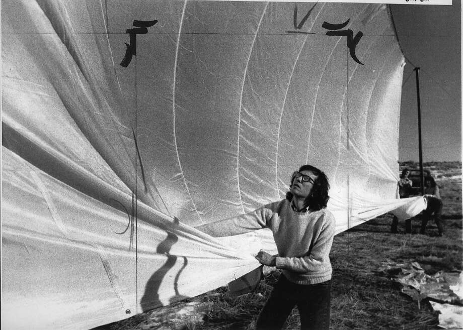 New York artist Christo Javacheff pulls on parachute type nylon cloth, which he used to build a 24 mile long running fence from Petaluma to the Pacific Ocean at a cost of $500,000, January 17, 1974.