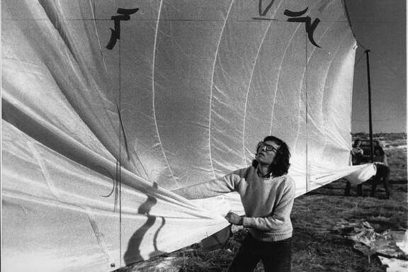 New York artist Christo Javacheff pulls on parachute type nylon cloth, which he plans to use with his next project: a 24 mile long running fence through from Petaluma to the pacific Ocean at a cost of $500,000, January 17, 1974  United Press International photo