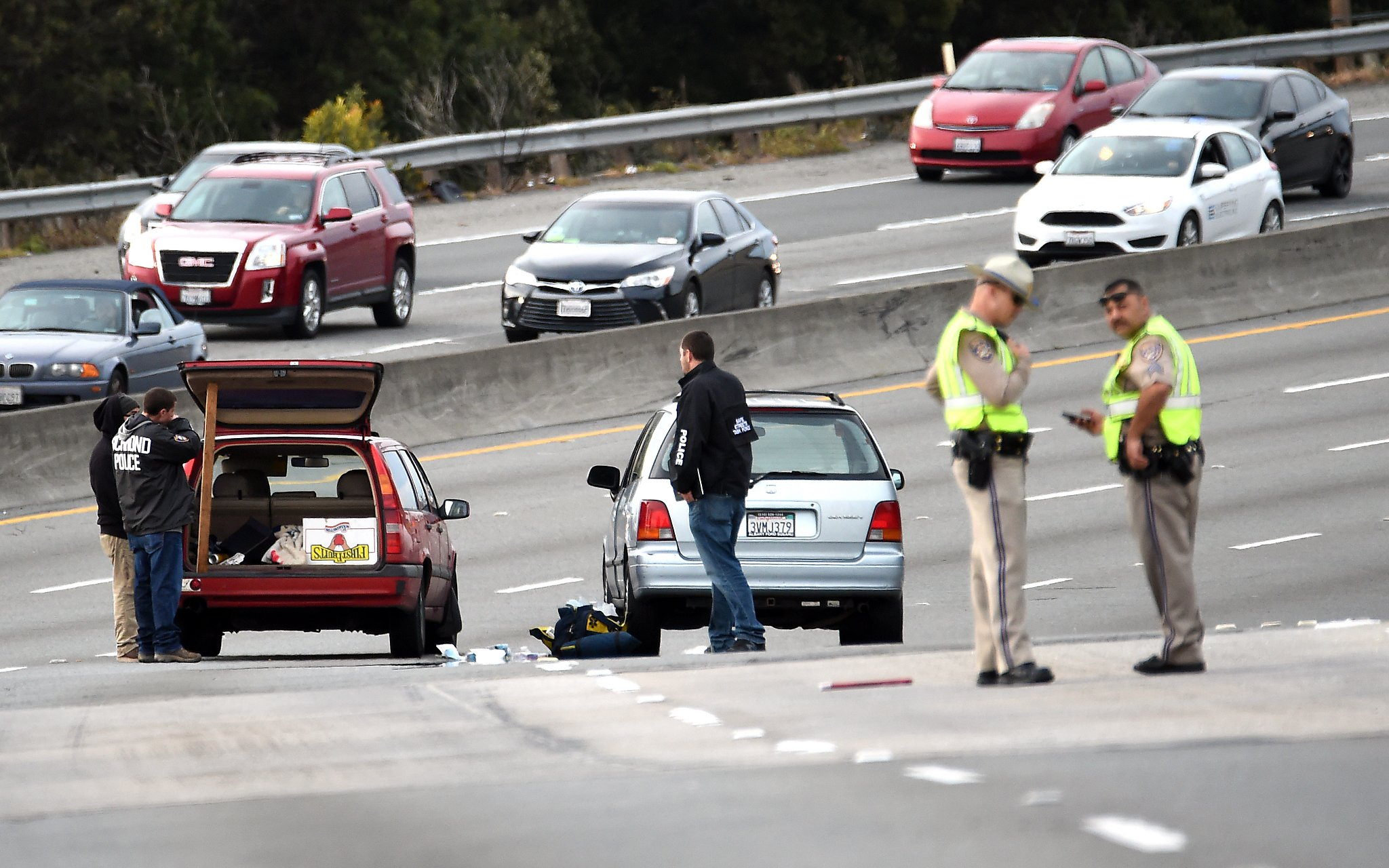 Shooting wounds 2, closes eastbound I-80 for hours in