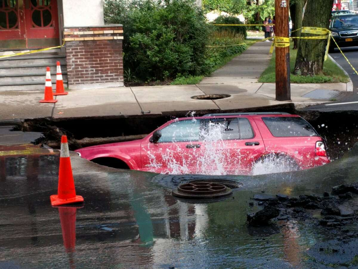 A sinkhole on Aug. 2, 2016, on South Lake Avenue where an Albany police officer said a water main leaked and is being shut down. (J.p. Lawrence/Times Union)
