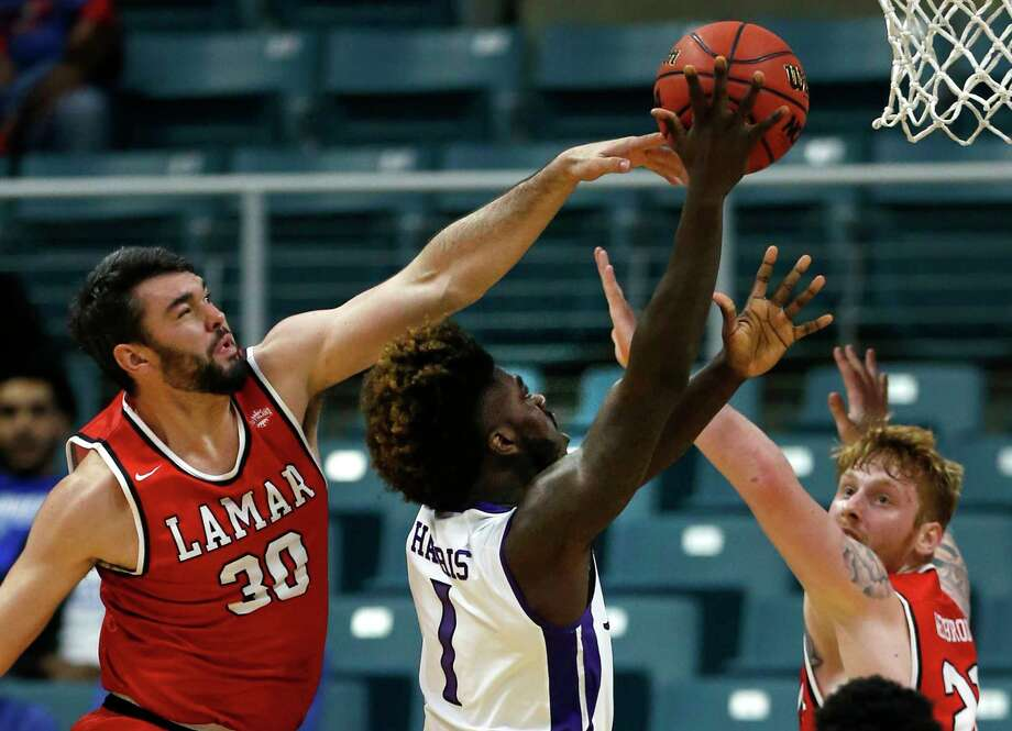 Lamar forward Christian Albright (30) defends a shot by Stephen F. Austin forward Kevon Harris (1) during the first half of a Southland Conference Tournament quarterfinal basketball game at the Merrell Center on Thursday, March 9, 2017, in Katy. ( Brett Coomer / Houston Chronicle ) Photo: Brett Coomer, Staff / © 2017 Houston Chronicle