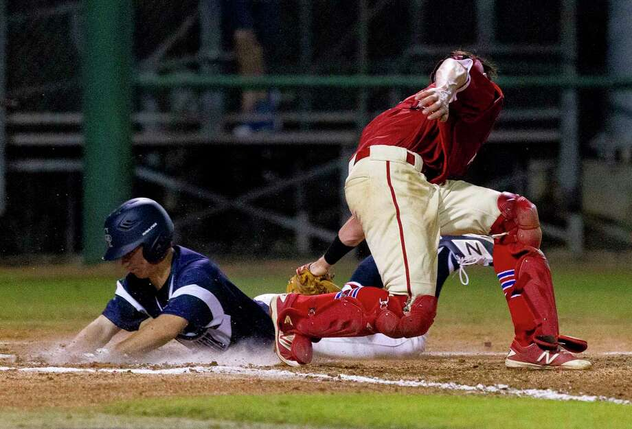 Luke Repka #6 of College Park beats the tag from Grapevine catcher Jonathan Hearn (7) to score on a 2-RBI double by Josh Trahan during the second inning of a high school baseball game at the Wings-N-More Classic Thursday, March 9, 2017, in Conroe. Photo: Jason Fochtman, Staff Photographer / © 2017 Houston Chronicle