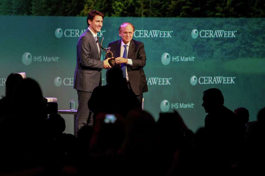 The Prime Minister of Canada, Justin Trudeau, left, receiving the CERAWeek Global Energy and Environment Leadership Award in recognition of his commitment to sustainability in energy and the environment. Presenting the award is Daniel Yergin, right, vice chairman of IHS Markit.  (For the Chronicle/Gary Fountain, March 9, 2017) Photo: Gary Fountain, For The Chronicle / Copyright 2017 Gary Fountain