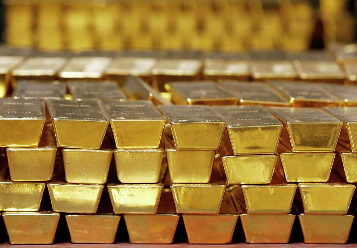 FILE - In this Tuesday, July 22, 2014, file photo, gold bars are stacked in a vault at the U.S. West Point, in West Point, N.Y. On March 9, 2017, one of the greatest runs for the stock market in history is marking its eighth anniversary, and this time investors are joining the party. Gold was looking like a better investment than even stocks in the summer of 2011, when its price surged to a record on worries about the U.S. credit rating, EuropeÂ?'s debt crisis and the possibility of higher inflation. But each of the concerns has dissipated, and $10,000 invested in the largest gold ETF on March 9, 2009, is now worth about $12,650. (AP Photo/File)