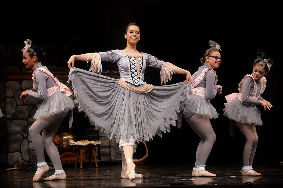 """Cinderella, played by Bailey Heartfield, dances with her mice during the final dress rehearsal for the Beaumont Ballet Theatre company's production of Cinderella onstage at the Jefferson Theatre Thursday. This year's presentation marks the 33rd year the company has performed the classic ballet, but the first time it will do so without renowned dance instructor Bonnie Cokinos, who passed away September 27, 2016, at the age of 82. For decades, Cokinos taught and inspired area dancers, several of whom have gone on to dance professionally. Several showings are scheduled for this weekend. Children's performances will be offered at 9;30 a.m. and 12:30 p.m. Friday, and the general performance will be held Friday at 7 p.m. There will also be a matinee performance at 2:30 p.m. Saturday. Heartfield, 18, began dancing at the Bonnie Cokinos School of Dance when she was 3, and says performing the lead role this time without """"Miss Bonnie"""" is difficult, but """"it also makes it more special, because it's for her,"""" she said. Photo taken Thursday, March 9, 2017 Kim Brent/The Enterprise Photo: Kim Brent / BEN"""