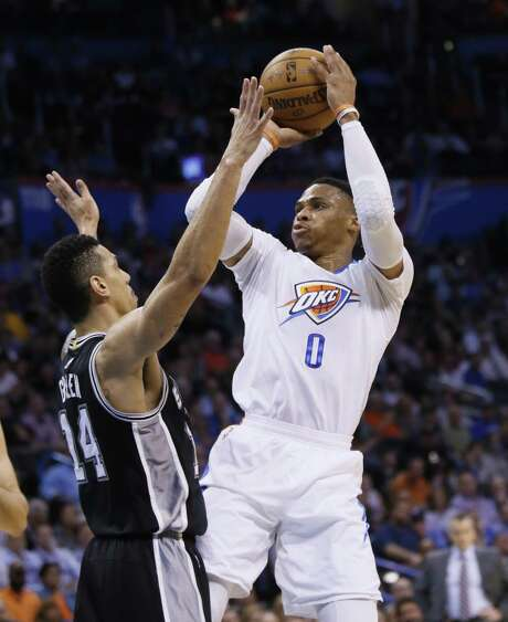 Thunder guard Russell Westbrook (0) shoots in front of Spurs guard Danny Green (14) during the first quarter in Oklahoma City on March 9, 2017. Photo: Sue Ogrocki /Associated Press / AP2017