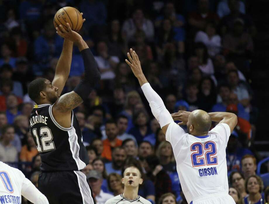 San Antonio Spurs forward LaMarcus Aldridge (12) shoots over Oklahoma City Thunder forward Taj Gibson (22) during the first quarter of an NBA basketball game in Oklahoma City, Thursday, March 9, 2017. (AP Photo/Sue Ogrocki) Photo: Sue Ogrocki, STF / Associated Press / AP2017