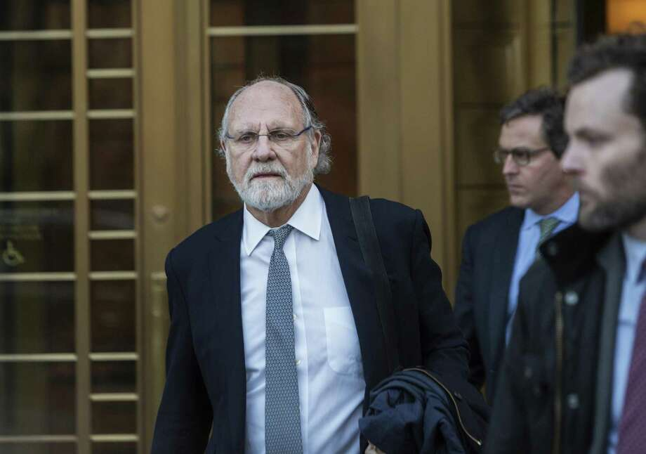Jon Corzine, former chairman of MF Global Holdings Ltd., exits district court in New York on Thursday. Corzine was summoned to the witness stand in MF Global Holdings Ltd.'s malpractice suit against the PricewaterhouseCoopers LLP accounting firm. Photo: Victor J. Blue /Bloomberg News / © 2017 Bloomberg Finance LP