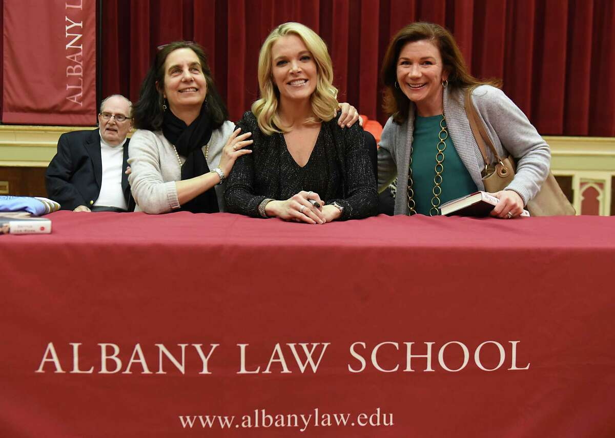 Megyn Kelly, Albany Law School alumna and NBC News anchor, center, is glad to see her class of '95 classmates Donna Rosen, left, and Maureen Harris as she signs her book, OSettle for More,O for fans and students at Albany Law School Thursday, March. 9, 2017 in Albany, N.Y. (Lori Van Buren / Times Union)