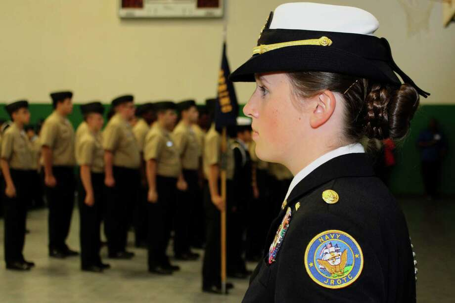 Spring High School Navy JROTC Cadet Regimental Commander Courtney Lundquist, right, oversees the regimental inspection. Photo: Spring ISD