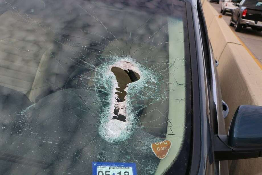 Photos provided by La Porte police show the damage to a vehicle after its driver was struck in the neck by a large flying bolt, March 2, 2017 on Highway 146. Police are looking for information on a large container truck that likely was the source of the flying debris. A $5,000 reward is being offered by Crime Stoppers.  Photo: La Porte Police Department