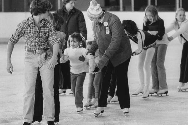 Nicole McMackin receives a helping hand from volunteer Donna Wright. Leading the processioon is Brian Holland while club pro Debbie Bressler watches in the backgound. January 1981