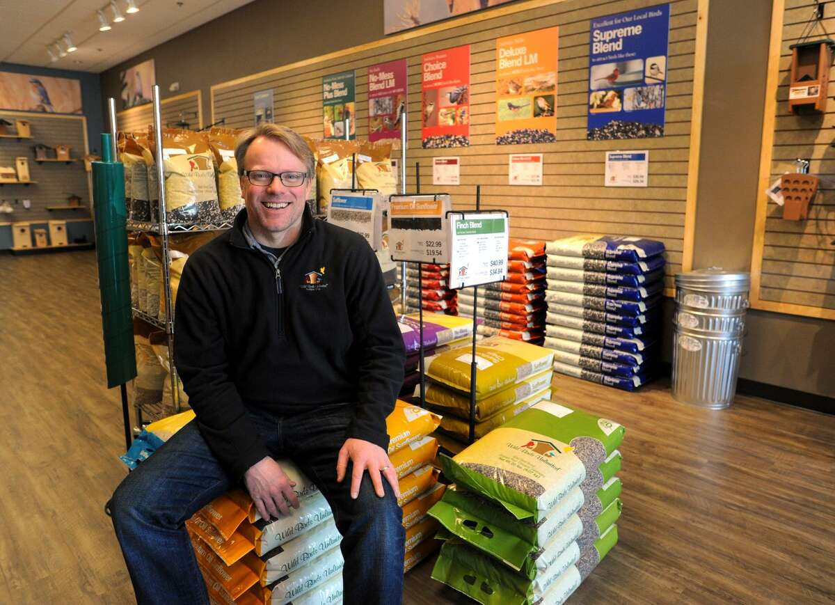 Chris Petherick, owner of the recently opened Wild Birds Unlimited in Fairfield, shows off the many varieties of seeds available at the store.