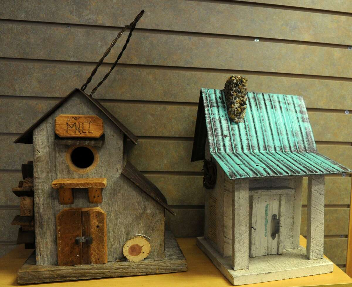 The recently opened Wild Birds Unlimited in Fairfield, Conn. offers a large variety of bird houses and other yard ornaments.
