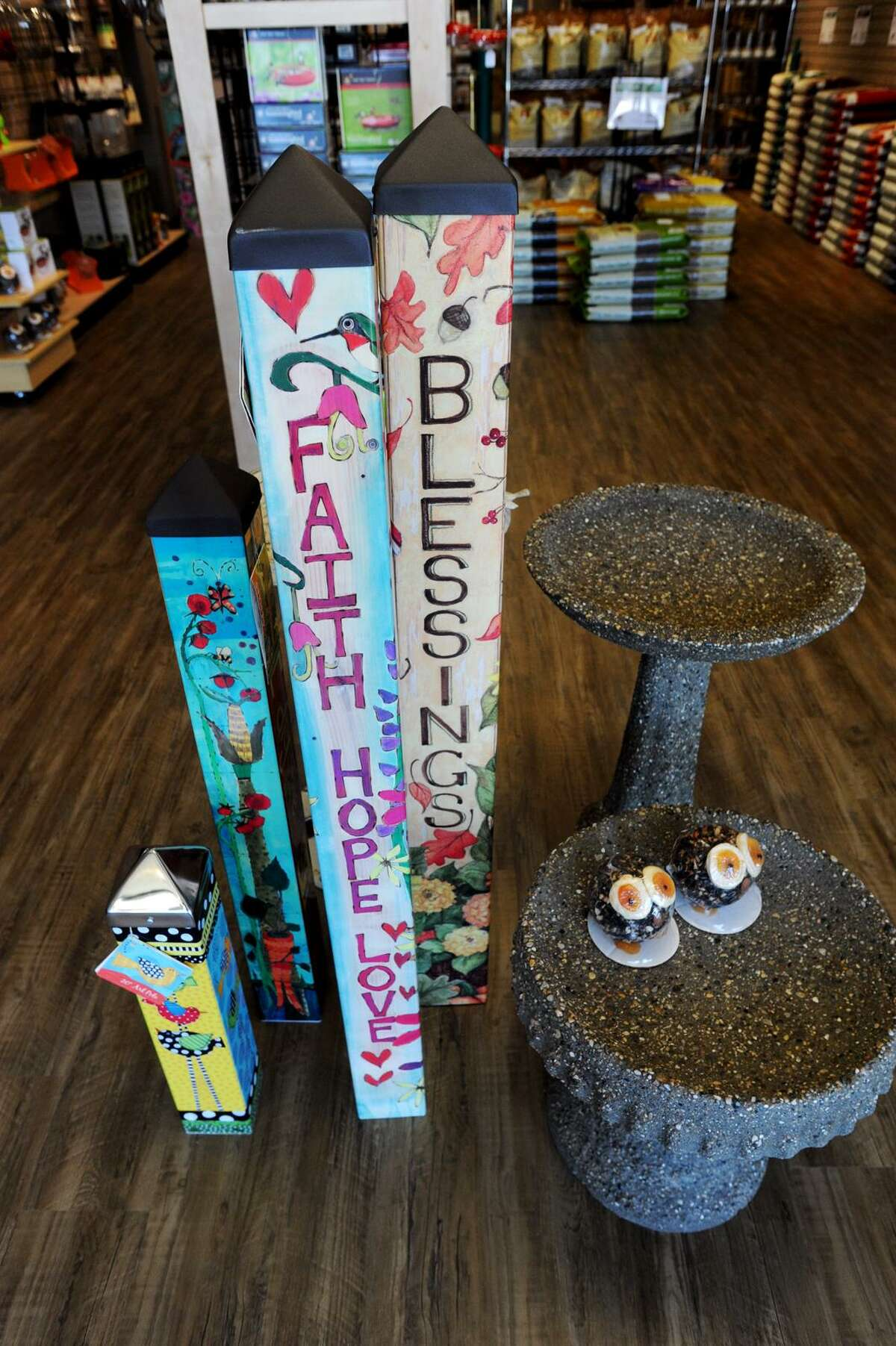 Wild Birds Unlimited in Fairfield offers a wide variety of items, like garden poles and birdbaths, to help people enjoy their backyard.