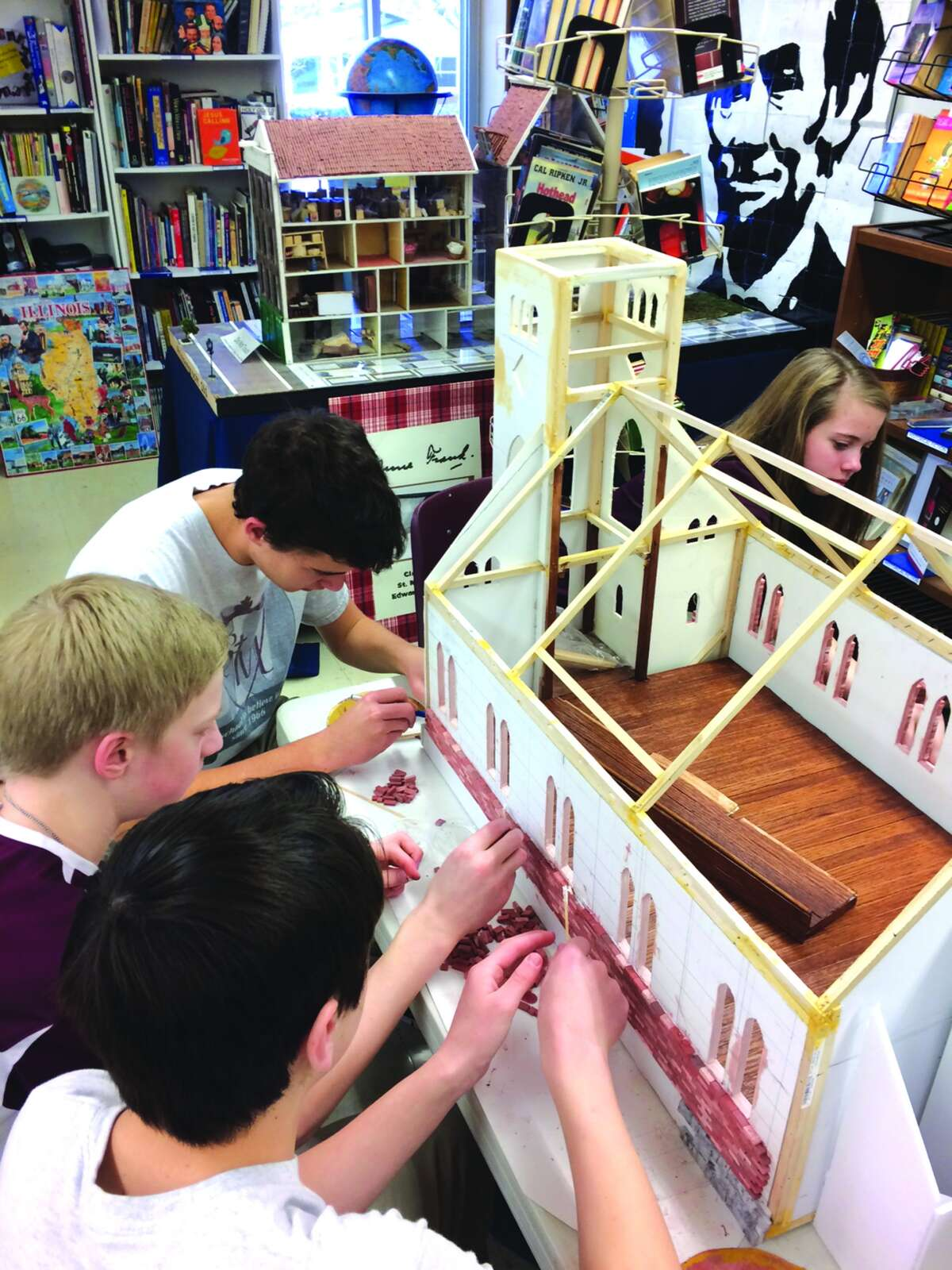 """Eighth-grade students work on their model of the """"old"""" St. Mary's Church."""