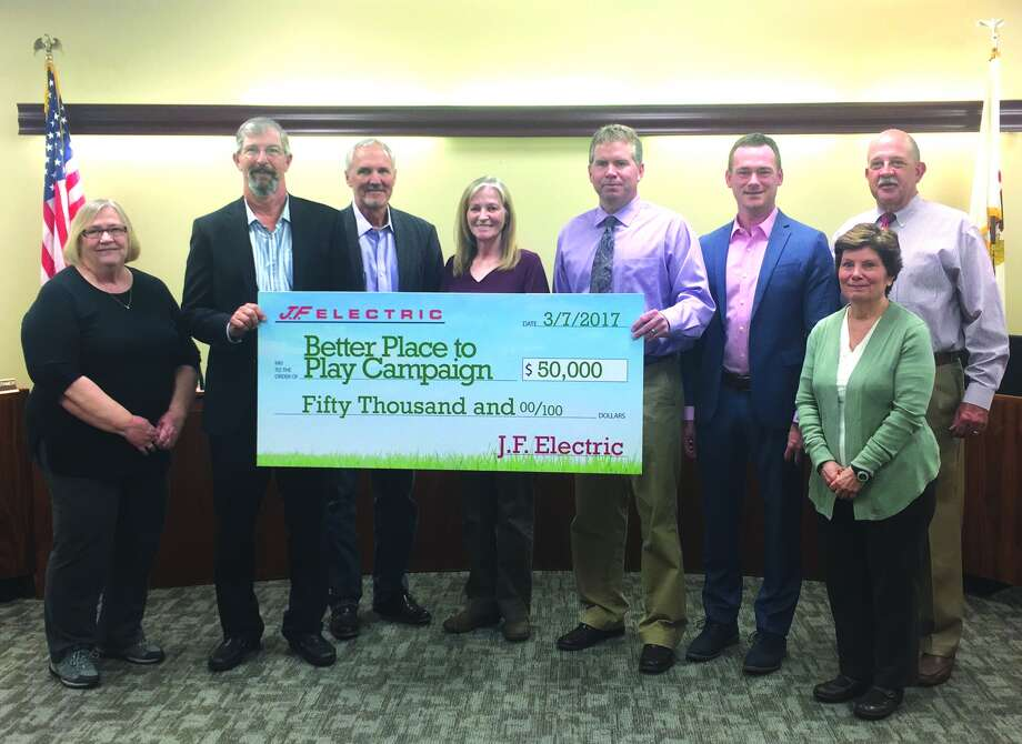 "President of J.F. Electric Greg Fowler, second from left, poses with the Edwardsville City Council after making a second donation to the ""Better Place to Play"" campaign. Photo: Cody King • Intelligencer"
