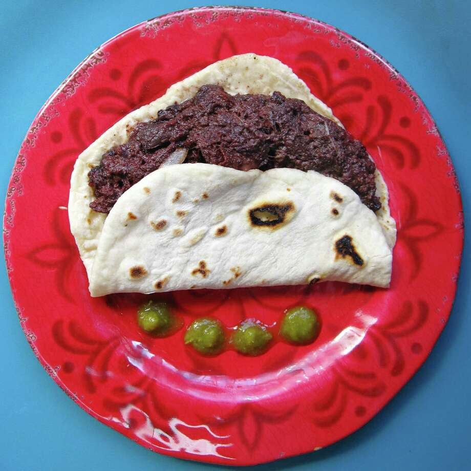 Morcilla taco on a handmade flour tortilla from Las Delicias Tacos #1 on West Commerce Street. Photo: Mike Sutter /San Antonio Express-News