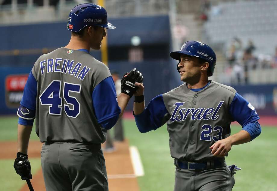 SEOUL, SOUTH KOREA - MARCH 07:  Outfielder Sam Fuld #23 (R) of Israel high fives with Nate Freiman (L) #45 after scoring a run in the top of the first inning during the World Baseball Classic Pool A Game Two between Israel and Chinese Taipei at Gocheok Sky Dome on March 7, 2017 in Seoul, South Korea.  (Photo by Chung Sung-Jun/Getty Images) Photo: Chung Sung-Jun, Getty Images