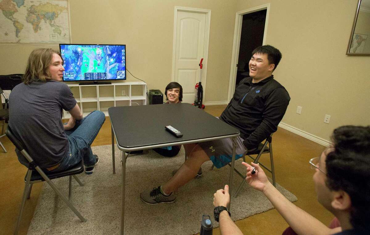 Texas A&M eSports team review and evaluate a video recording of a game the team played earlier that week to strategize for their next playoff matchup Saturday, March 4, 2017, in College Station. Clockwise: Zac Acosta, Andrew Oh, Youssef Elmasry and Joey Bowers. ( Yi-Chin Lee / Houston Chronicle )
