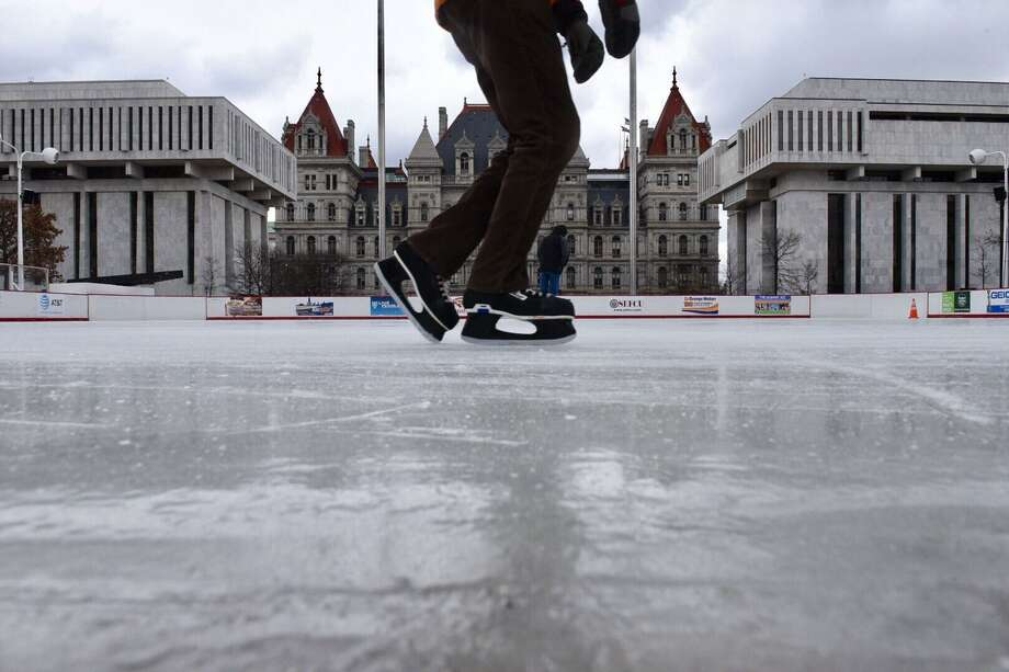 Skaters take to the ice on Friday, March 10, 2017, the last weekend for the 2016-17 season at the Empire State Plaza ice rink in Albany. (WWill Waldron/Times Union) Photo: Skating