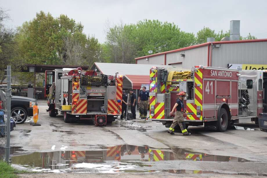 A fire that originated in the paint booth of an auto-body shop in the far Northwest Side on Friday caused about $65,000 in damage. Photo: Caleb Downs / San Antonio Express-News