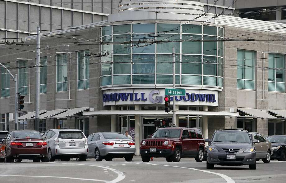 The thrift store and adjacent Goodwill headquarters at a busy intersection would be replaced with a 39-story residential tower. Photo: Paul Chinn, The Chronicle