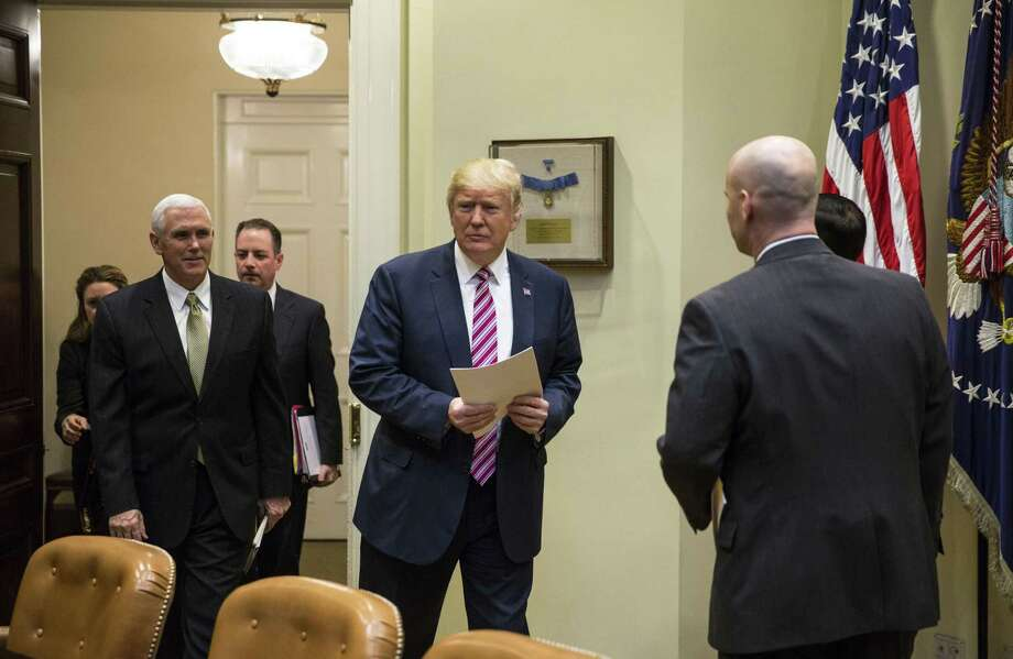 President Donald Trump arrives with Vice President Mike Pence for a healthcare discussion with House committee chairs, in the Roosevelt Room of the White House, in Washington, March 10, 2017. (Al Drago/The New York Times) Photo: AL DRAGO / NYT / NYTNS
