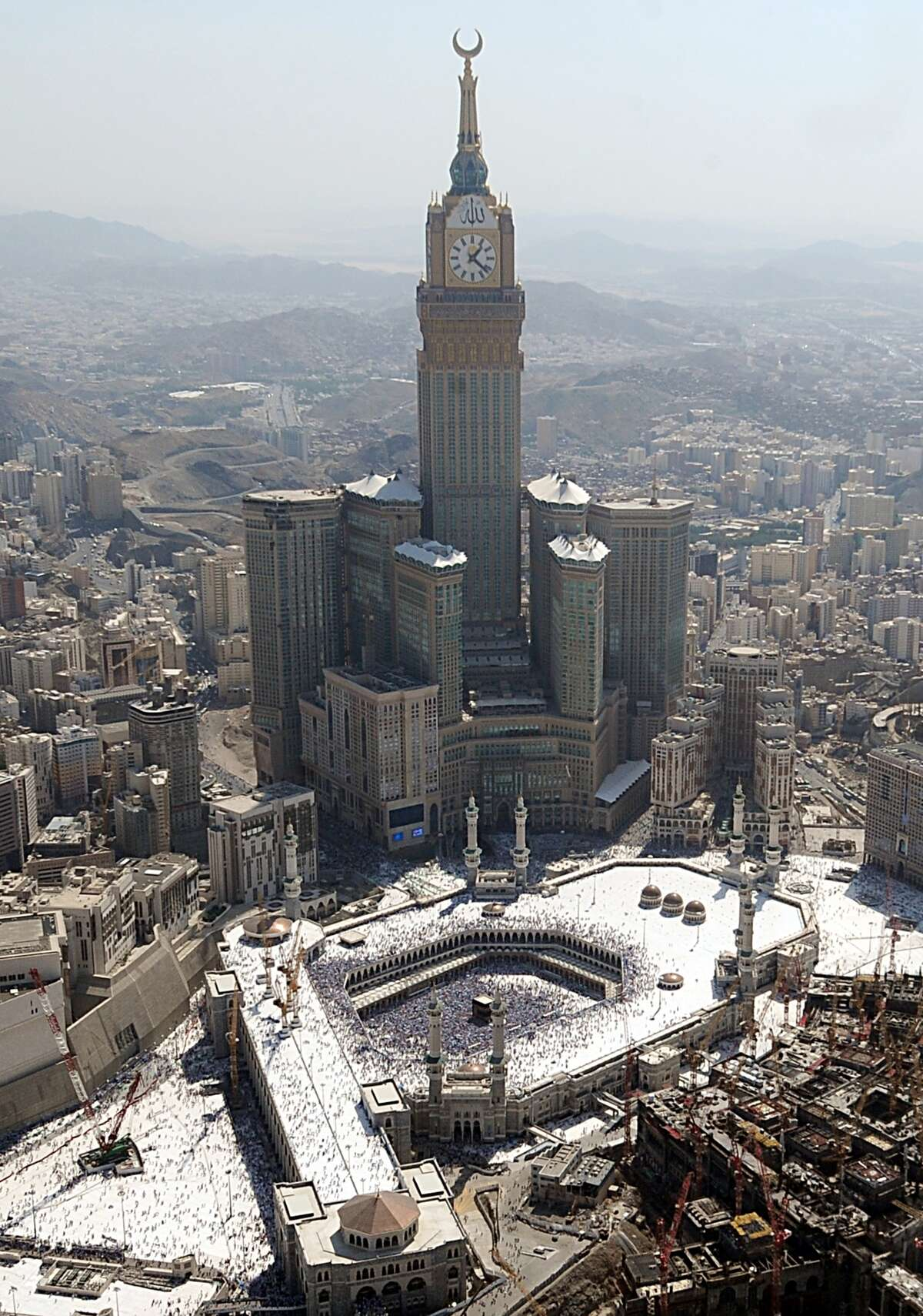 The Abraj al-Bait Towers, also known as the Mecca Royal Hotel Clock Tower in Mecca, Saudi Arabia is the most expensive building in the world, costing $15 billion to construct. It overlooks the holy Grand Mosque of Mecca.