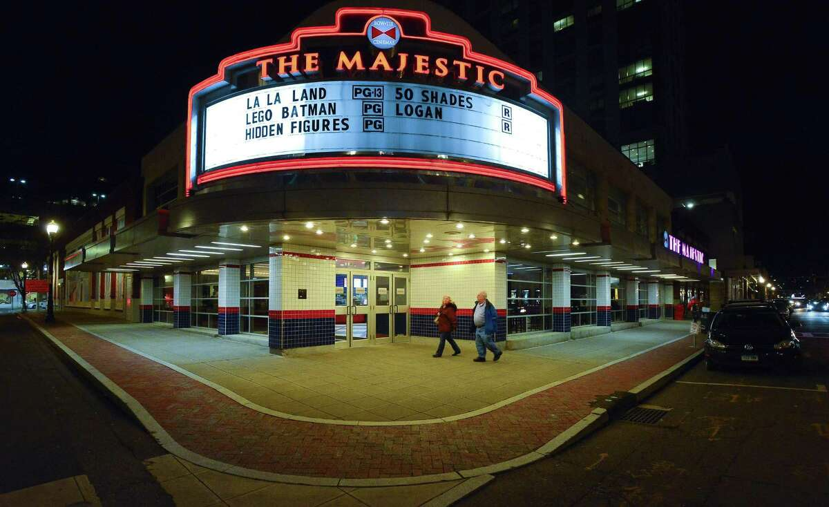 Area residents pass by The Majestic 6 movie theater, part of the Bow Ties Cinemas chain on Summer Street in Stamford, Conn. on March 8, 2017.
