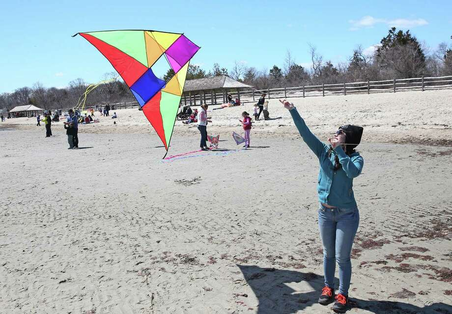 Marilyn Albanese Of Greenwich Looks To Lift Off Her Kite During Saay Afternoon Annual Flying
