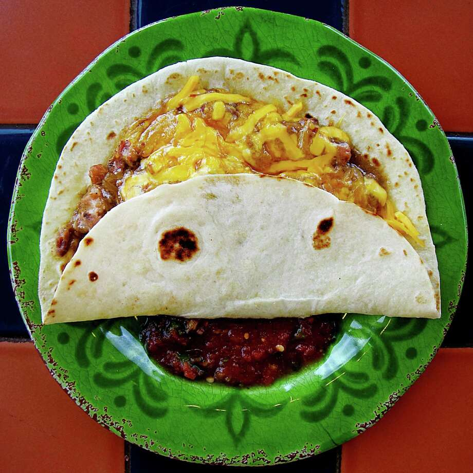 Carne guisada taco with cheese on a handmade flour tortilla from Apetitos Mexican Restaurant on Meadow Way. Photo: Mike Sutter /San Antonio Express-News