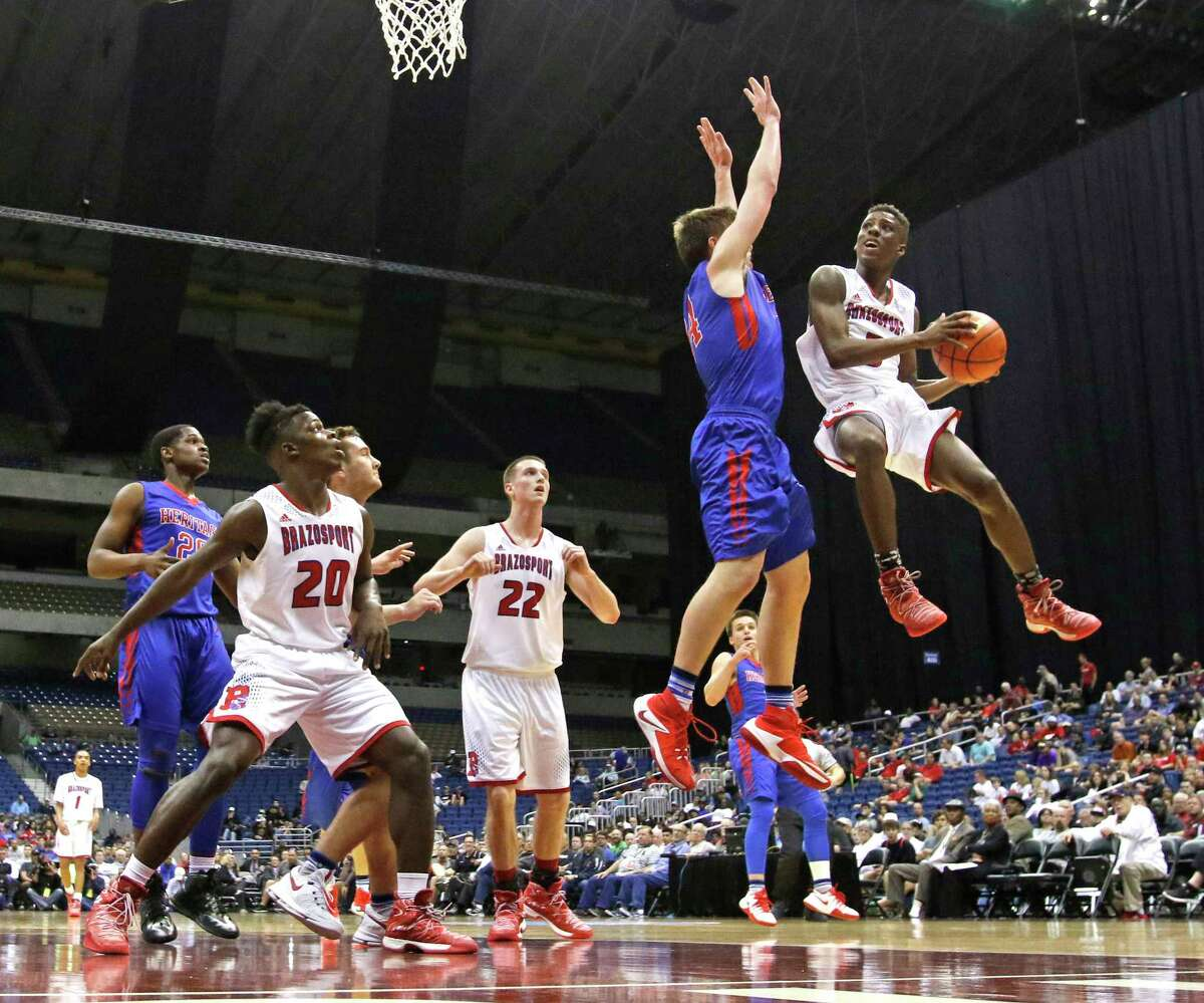 Freeport Brazoport's Jalen Johnson (3) drives on Midlothian Heritage player from 4A semi-final game between Freeport Brazosport vs. Midlothian Heritage on Friday, March 10, 2017 at the Alamodome.