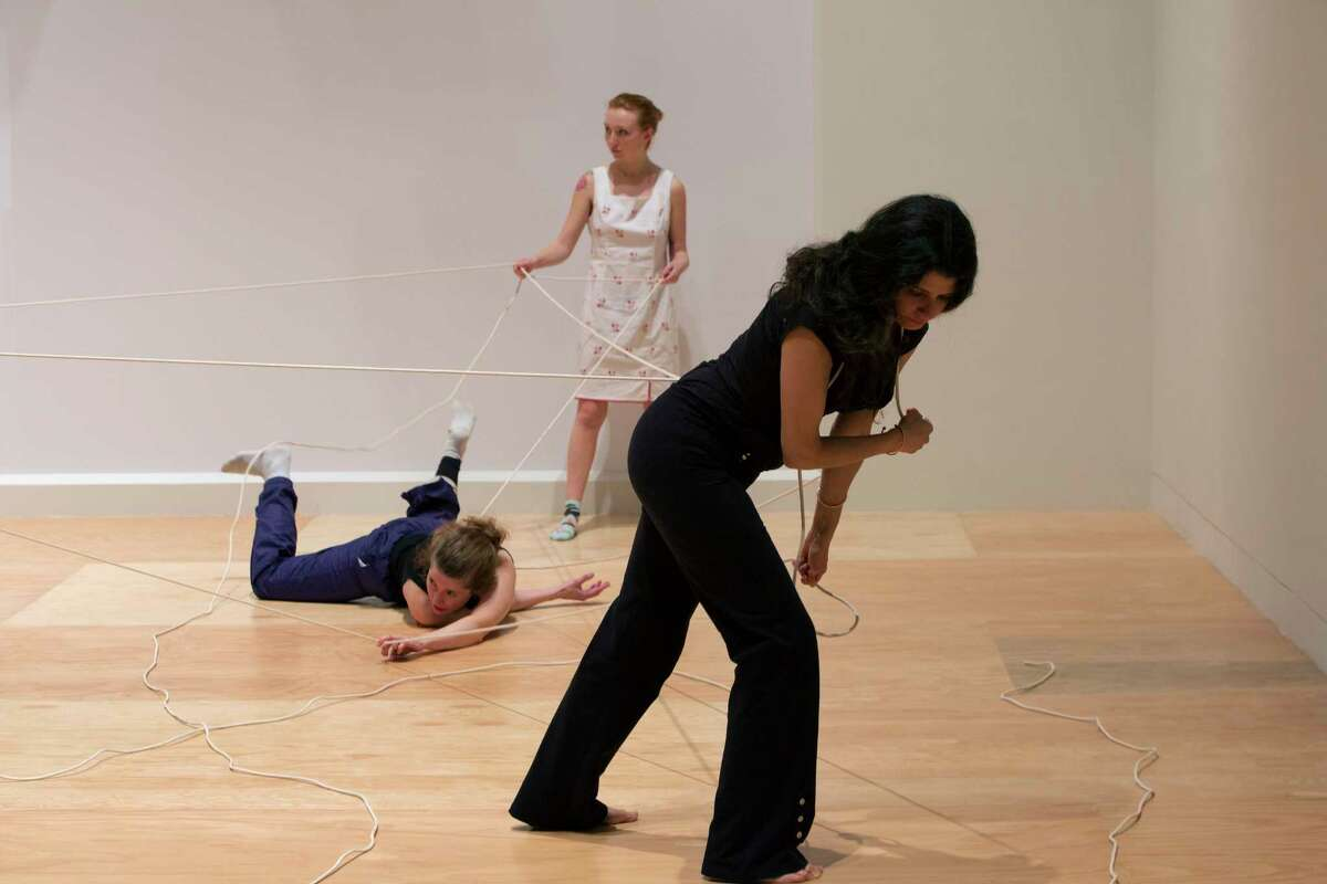 Rope Dance, 2015. Concept, title and score by Anna Halprin. Interpretations and variations by Janine Antoni, foreground, and Stephen Petronio. Commissioned by The Fabric Workshop and Museum, Philadelphia. Rope Dance performance part of Entangle at the Tang Teaching Museum at Skidmore College. Photograph by Arthur Evans.