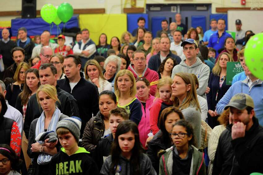 Parents watch their kids get their heads shaved during the Stratfield Elementary School Fighting Molonys 9th annual St. Baldrick's Foundation event at the school in Fairfield, Conn., on Wednesday Mar. 8, 2017. The St. Baldrick's Foundation is a volunteer-powered organization dedicated to raising money for children's cancer research.