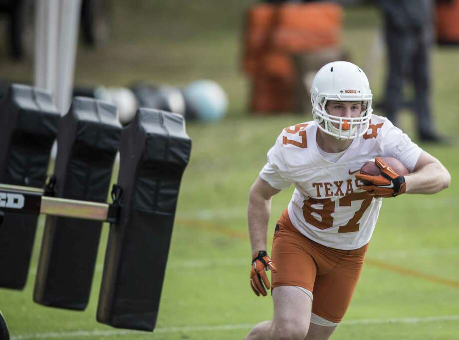 Longhorns receiver Garrett Gray goes through drills during spring practice Tuesday. Photo: Ricardo B. Braziell / Austin American-Statesman