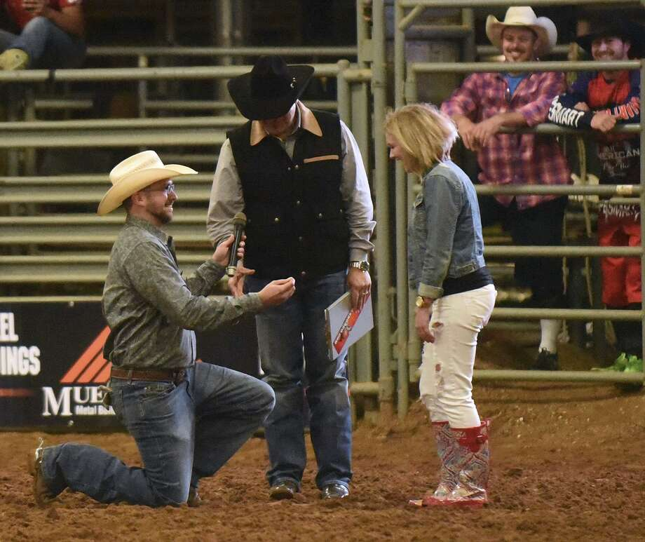 Clayton Peterson proposes to Molly Mae Cates at Tejas Rodeo in Bulverde. The venue offers dining, a rodeo per- formance and other events. Photo: Billy Calzada / San Antonio Express-News / San Antonio Express-News