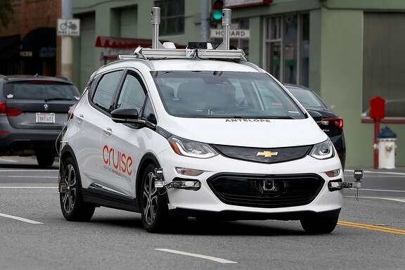 A self-driving car operated by Cruise rides on 11th Street in San Francisco, Calif. on Friday, March 10, 2017. The Department of Motor Vehicles is announcing proposed regulations for testing and deploying self-driving cars on public roadways.