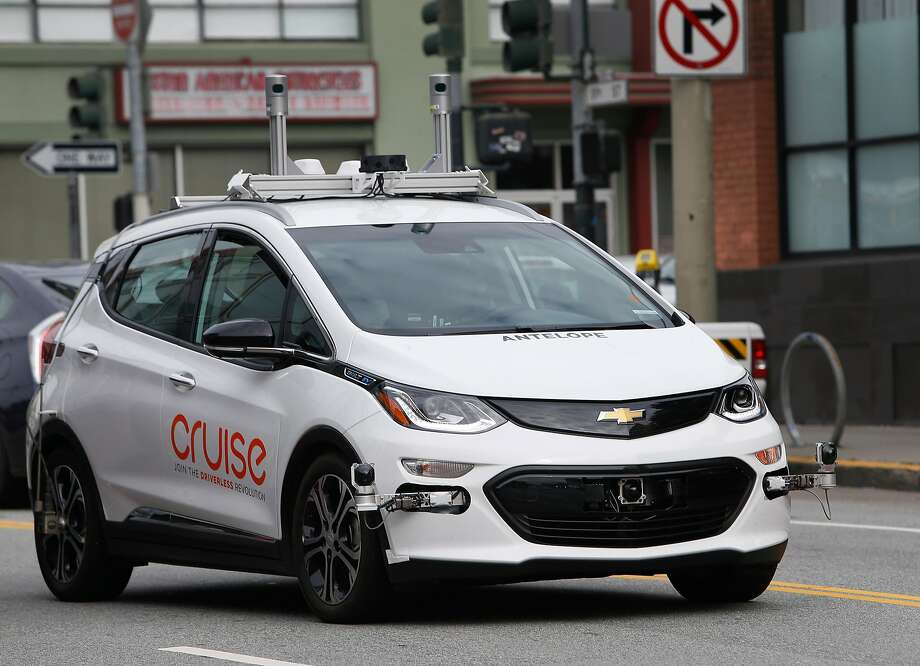A Cruise self-driving car rides on 11th Street in San Francisco in March. The vehicles will soon be tested in New York City, too. Photo: Paul Chinn, The Chronicle