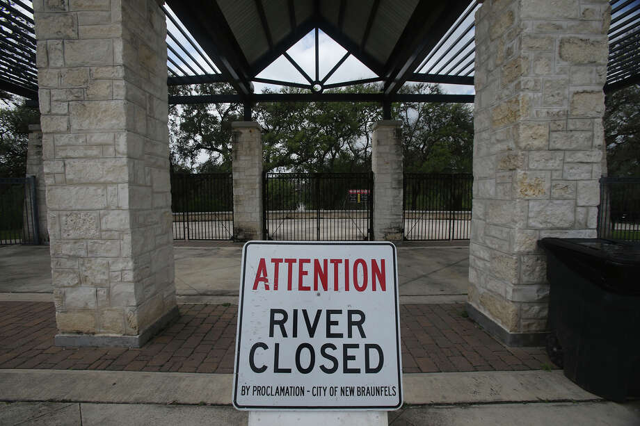 A sign at Prince Solms Park in New Braunfels lets visitors know that the Comal River is closed. Recent rainfall has caused the river level to rise. Photo: John Davenport, San Antonio Express-News / ©San Antonio Express-News/John Davenport