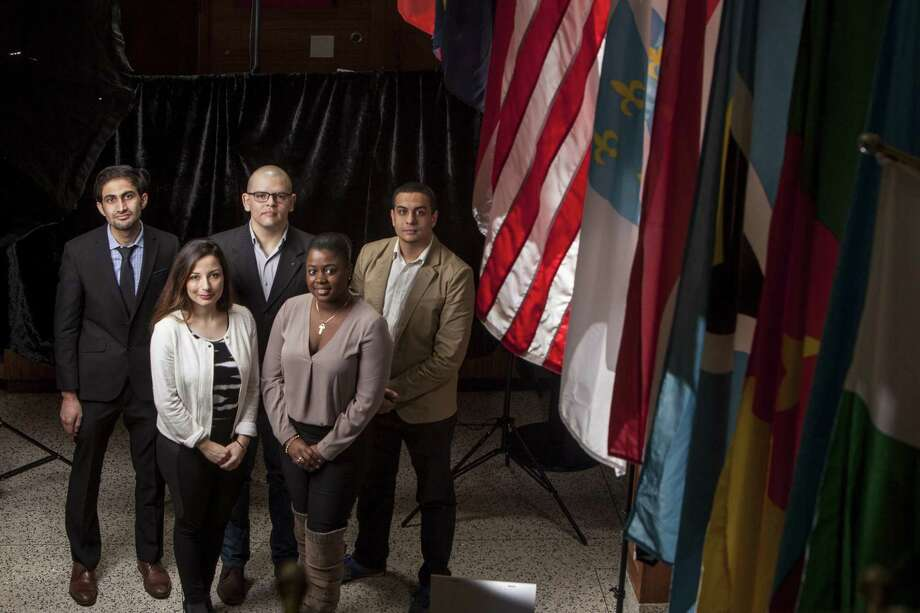 The University of Bridgeport has six international students who have been awarded Fulbright Scholar grants to study in the United States and have enrolled at the school to earn graduate degrees. Left to right, Mohammad Yahya Nafi (Afghanistan), Doha Sabbagh (Lebanon) Felipe Zapata-Roldan (Colombia), Samantha Grand Pierre (Haiti) and Seifallah Mejri (Tunisia). Photographed in the Cox Student Center on the campus in Bridgeport, Conn. on Thursday, March 2, 2017. Missing from photo is Lamia Ben Halim, a student from Libya. Photo: Johnathon Henninger / For Hearst Connecticut Media / Connecticut Post Freelance