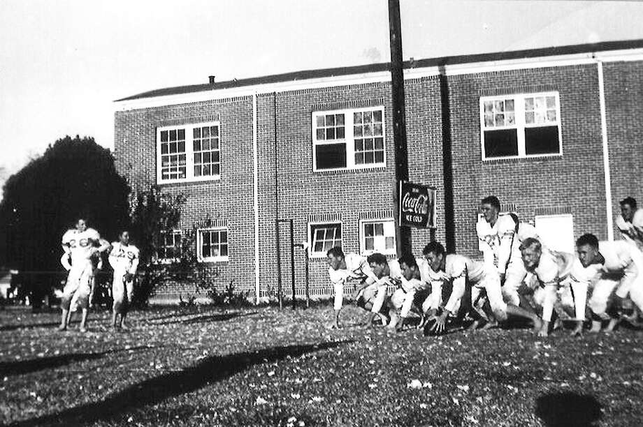 HereÂ's a 1930 football practice of the Dayton Broncos on SH 90 in front of the old gymnasium. The Dayton Sports Hall of Fame is seeking photos from residents and former athletes for use in the museum. Photo: Submitted